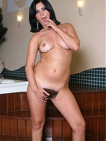 Hairy MILF Bianca puts her curves and thick bush on display during a live cam show